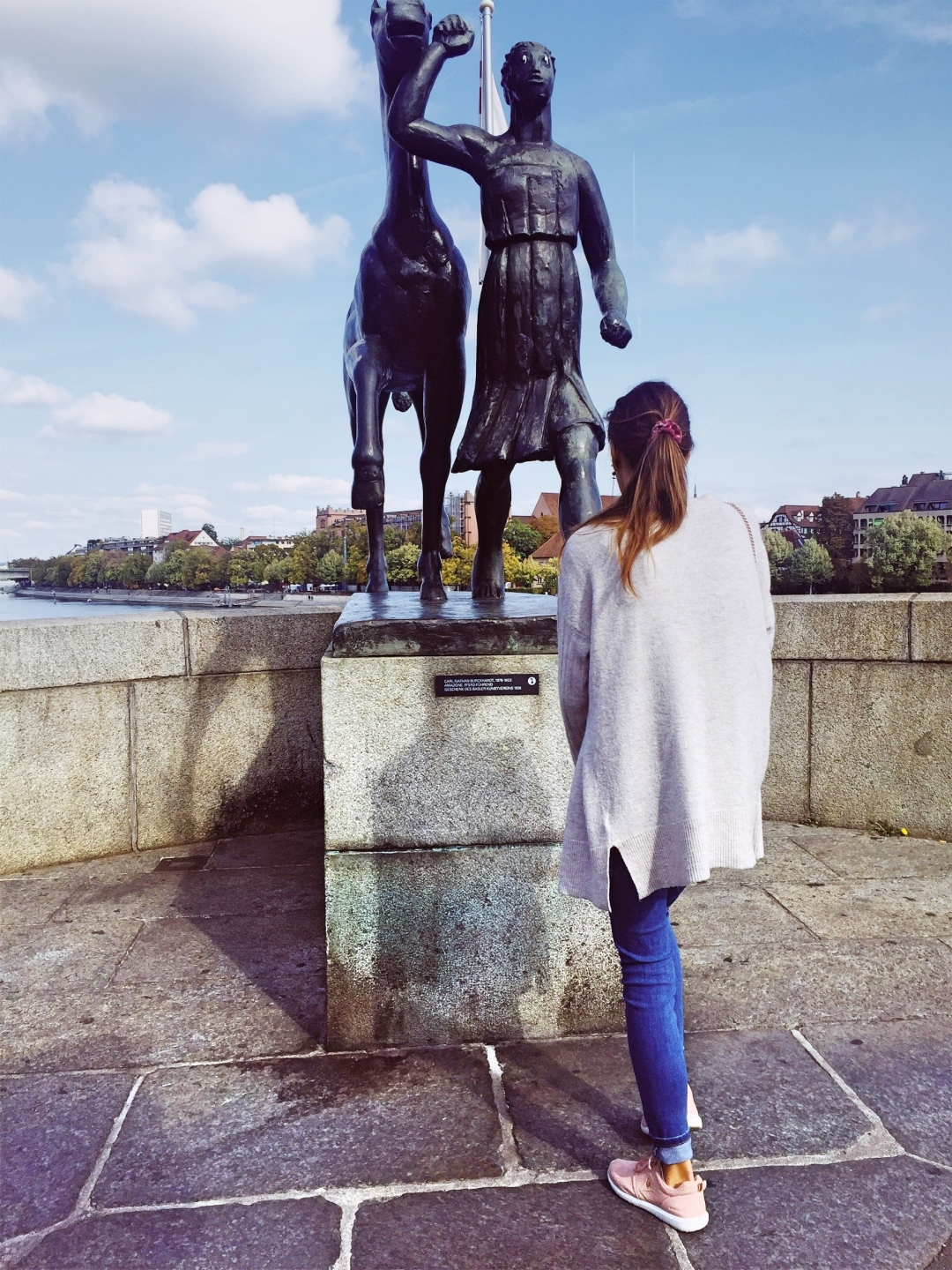 Rhine river Mittlere Brucke basel - statue amazon with a horse