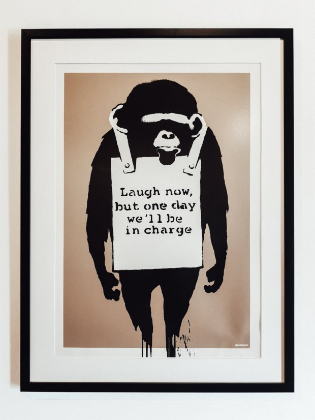 Banksy Monkey with sandwich board Laugh Now 2003