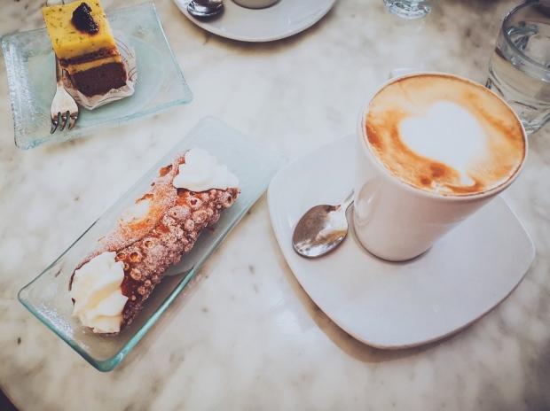 Cannolo and cappuccino in Caffè Sicilia in Noto Sicily